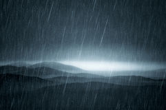 Dark landscape with rain. Over meadows on a dark autumn day Royalty Free Stock Photos