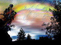 Dark landscape with rainbow, heavy rain and silhouettes of trees Stock Photography