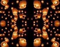 Dark lanterns mirrored. Floating lanterns in the night sky Stock Photo