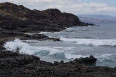 Dark lava rocks with Atlantic coast stock photography