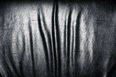 Dark leather folds. Stock Photo