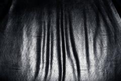 Dark leather folds. Stock Photography
