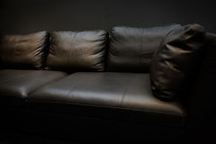 Dark leather sofa Stock Images