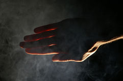 Dark or light?. Man hand showing the line between good and bad, dark and light Stock Photo