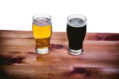 Dark and light beer on the bar on a white background Royalty Free Stock Photography