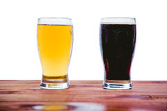 Dark and light beer on the bar on a white background Royalty Free Stock Images