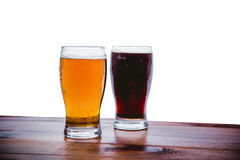 Dark and light beer on the bar on a white background Royalty Free Stock Image