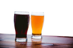 Dark and light beer on the bar on a white background Royalty Free Stock Photos