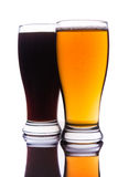 Dark and light beer into glasses Stock Photography