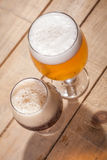 Dark and light beer on wood Royalty Free Stock Images