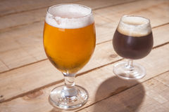 Dark and light beer on wood Stock Photos