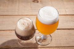 Dark and light beer on wood Royalty Free Stock Image