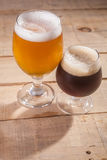 Dark and light beer on wood Royalty Free Stock Photos