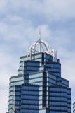 Dark and Light Blue Glass Office Tower with White Trim Stock Photo