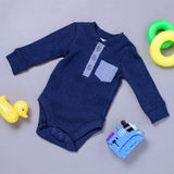 Dark and light blue onsie with toys Stock Photo