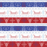 Dark and light blue, and red Nordic Christmas seamless pattern with santas sleigh, reindeer, snowflakes, stars decorative ornament Stock Photo