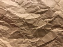 Dark and light brown, cream board as crumpled foil gilding paper. Dark and light brown, cream hills view. It is suitable using as background and texture.  Image Stock Photos