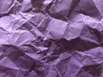 Dark and light purple board as crumpled foil gilding paper . Dark and light purple hills view. It is suitable using as background and texture.  Image like a Royalty Free Stock Images
