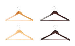 Dark and light wooden hangers isolated. Over the white background, each in two foreshortenings Royalty Free Stock Images