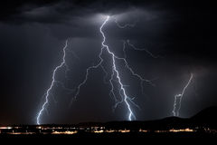 Dark Lightning. Multiple lightning bolts during a thunderstorm stock photo