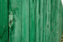 Dark lime vintage wooden boards. Backgrounds textures fence painted. Front view. Attract a beautiful vintage background. Stock Photo