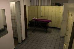 Dark locker room and shower. For sports stock image