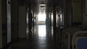 Dark long corridor in the hospital. Dark long corridor with a bed in the hospital stock video