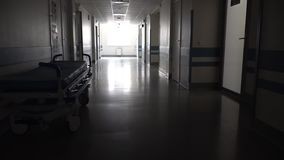 Dark Long Hallway with the Medical Gurney. In Hospital stock footage