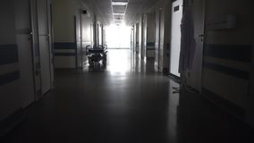 Dark Long Hallway with the Medical Gurney. In the Hospital stock video footage
