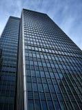 Dark looming offDark looming office block. Dark looming office block with dramatick sky Stock Images