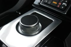 Dark luxury car interior, shift lever royalty free stock photography