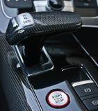 Dark luxury car Interior - steering wheel, shift lever royalty free stock photography