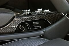 Dark luxury car Interior. Karbon. Interior detail stock photo