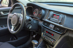 Dark luxury car Interior - steering wheel, shift lever and dashboard royalty free stock photo