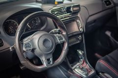 Dark luxury car Interior - steering wheel, shift lever and dashboard Stock Images