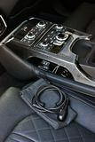 Dark luxury car Interior. Tuning. Karbon. Interior detail royalty free stock image