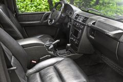 Dark luxury car Interior. Tuning. Karbon. Interior detail royalty free stock photo