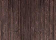 Dark mahogany brown wood tone textured background. Dark mahogany brown wood tone surface textured background Royalty Free Stock Photo