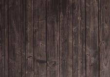 Dark mahogany brown wood tone textured background. Dark mahogany brown wood tone surface textured background Stock Photos