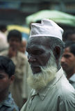 Dark man with a beard in the streets of India Royalty Free Stock Photography