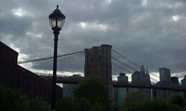 Dark Manhattan New York USA. Storm clouds over Manhattan and Brooklyn Bridge New York royalty free stock image