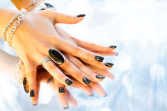 Dark manicure Stock Images