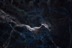 Dark marble texture shot through with white deep veining. Pattern for backdrop or background, And can also be used create marble effect to architectural slab Stock Photo