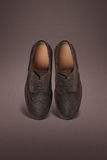 Dark men suede shoes. On dark background royalty free stock photos