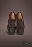 Dark men suede shoes. On dark background Royalty Free Stock Photography