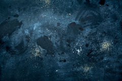 Dark messy background - tabletop with stains and sugar. Royalty Free Stock Photo