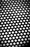 Dark metal lattice on gray background. Stock Photos