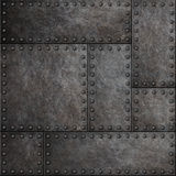 Dark metal plates with rivets seamless background or texture. Dark stained metal plates with rivets seamless background royalty free stock photo