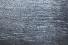 Dark metallic background, steel texture blackened patina Royalty Free Stock Images