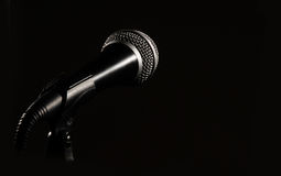 Dark mic. A dark microphone isolated on black Royalty Free Stock Photos